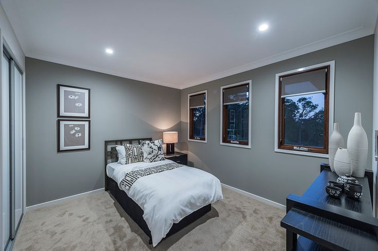 #Bedroom #interior #design #inspiration from #Ausbuild's Newbury display home. This #bedroom features soft #white #mocha carpet combined with a light grey feature wall and deep wooden #furnishings.