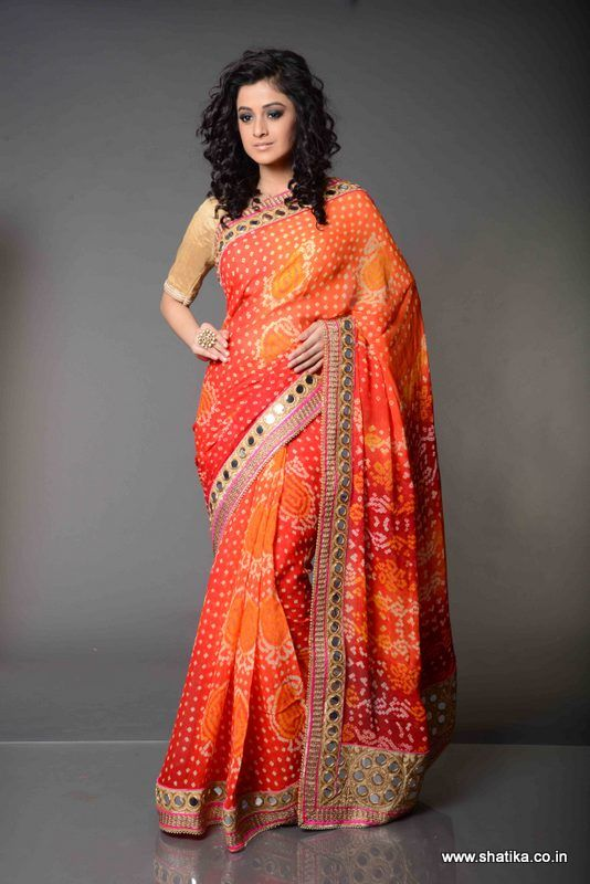 Amanpreet Mirror Work Bordered Pure Bandhej Saree: The dazzling and vibrant Amanpreet Thread Work Bordered Bandhej Saree is an endowment of pure Bandhej Sarees. A marvelous piece of Bandhej art, its beauty lies in the delicate mirror worked patch border in contrasting colours attached around the sari taking it to another level.