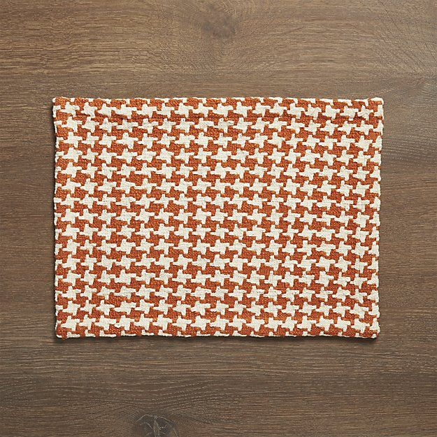 Cozy yet contemporary placemat jazzes up the traditional houndstooth. Scaled up in orange and cream, the pattern gets extra texture from chunky cotton slub yarns.