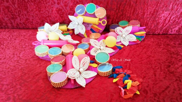 Mini Holi Hampers Designed At Wrap A Smile !  Why Go empty handed this Holi !  The perfect Mini Holi Tray with colors, a mini Pichkari & Balloons ! #Bright #Shine #Colorful #Bling #Rang #Bhang #HoliHai #letsplayHoli #fun #colorfulyou #colorfulgift #giveaways     Colors & sizes can be customized as per requirement. For Orders/inquiries drop me an email on wrapp.a.smile@gmail.com  Follow us on Fb - https://www.facebook.com/WrapASmile Instagram - wrapasmile/ahujashreya89