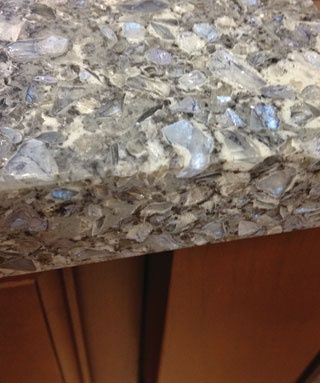 engineered quartz countertop. Except with white or black cupboards