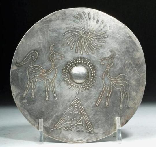 Viking Silver Disc, 9th-11th Century AD - Hammered and stamped silver disc with a sun, 2 stags and triangle symbols, from Northern Europe, probably the Eastern area, 11.9 cm
