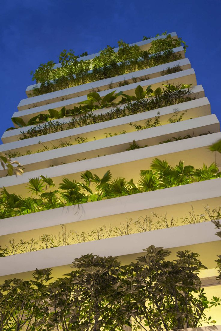 Architecture, Awesome Stacking Green Vo Trong Nghia With Small Plant Decorations In Every Front Row Of Each Floor Beautified With Lighting Effect: Green Building as Our Inspiration in Making Plant Rows Decoration