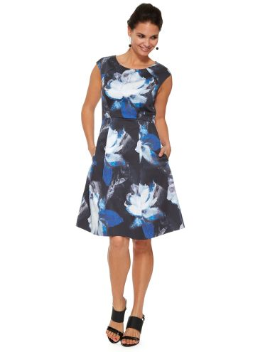 This sleeveless dress features an all-over floral print while the waist cinches in slightly. It is knee-length.