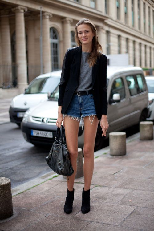 Street Style Spring 2013: Paris Fashion Week | Irina Kulikova shows off her legs for days in denim cut offs and black booties.