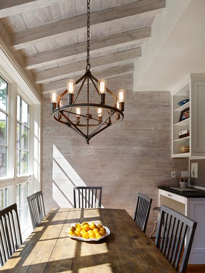 Salvaged-wood walls. The rustic look of reclaimed boards on the walls, along with the exposed ceiling boards and rafters, gives this welcoming dining room a barn-like feeling...I like this wood
