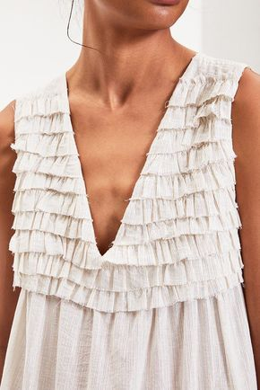 STYLE DETAILS - This stunning tiered maxi dress features lurex threading throughout for a hint of shine. Ruffled detailing, a V neck, and hand-twisted tassels complete the look. - 70% cotton, 30% lure