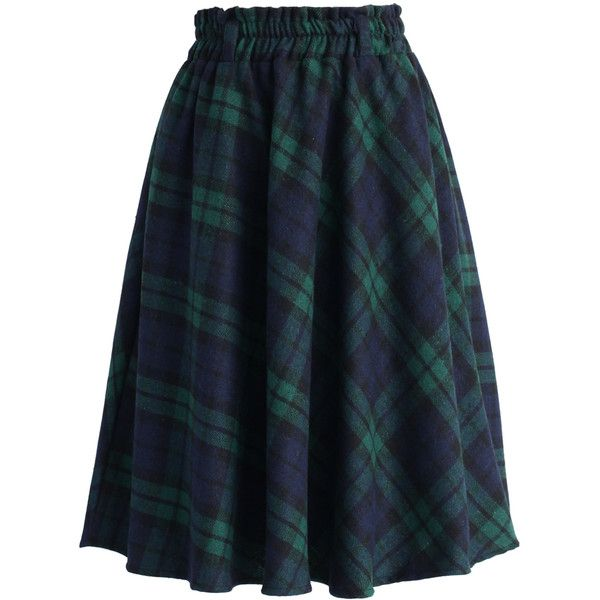 Green tartan pattern all over ; Crafted from wool;blend like fabric ; Not lined ; Concealed side zip closure ; 100% Polyester ; Machine washable.
