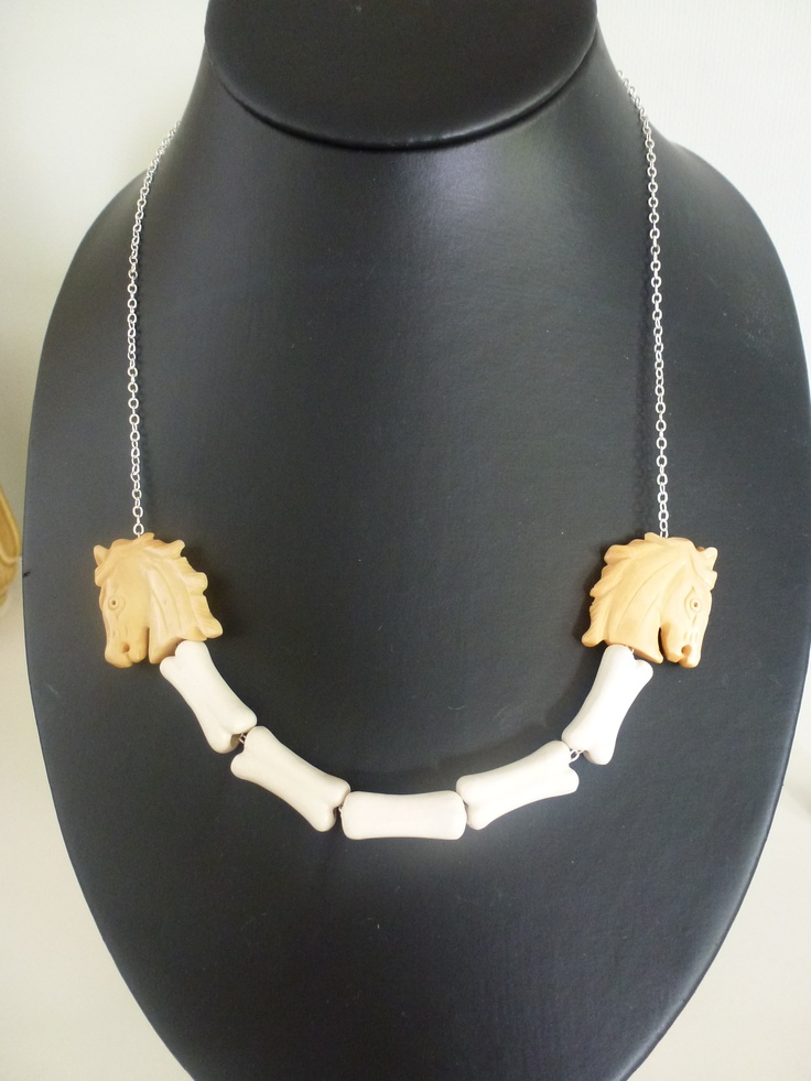 Ceramic bones and bone horse heads on a silver chain.