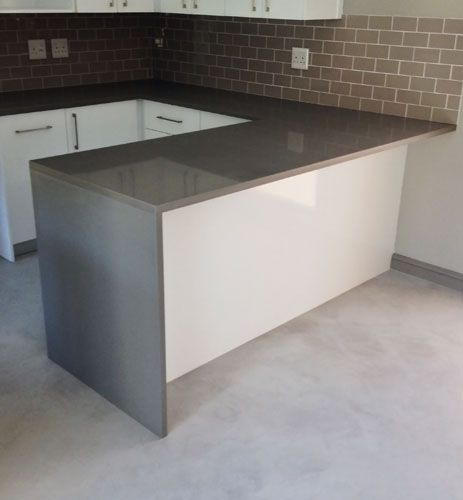 Cafe Quartz Storm kitchen top with bud joint leg. Cafe Quartz comes in 6 colors and is an affordable alternative engineered stone range. Rock  Stone manufactured and install this kitchen.