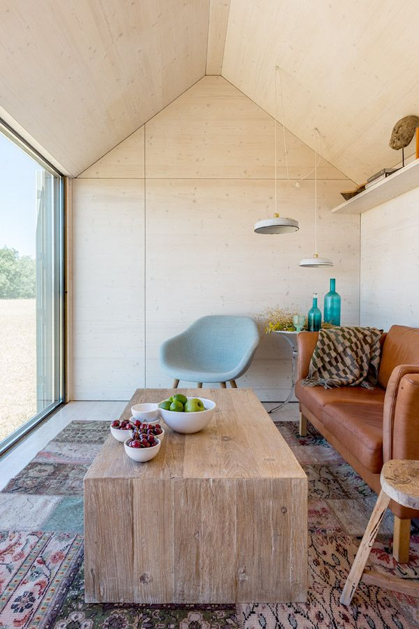Inside the ÁPH80 portable home by Spanish firm ÁBATON. The Hay About a Lounge Chair is looking cosy :-) http://www.nest.co.uk/browse/brand/hay/hay-about-a-lounge-chair-low-4-leg-base