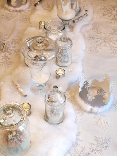 Beautiful table setting for a winter (grown up) princess party.  All those glass container just wouldn't work for me at a kid party but I would LOVE this for a party for me.