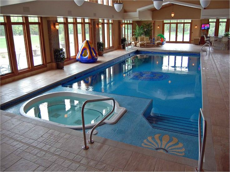 Luxury indoor swimming pool with hot tub.