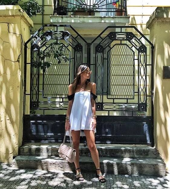 Vintage doors... <3 📷 Fashion blogger Shoprano in strapless stripe on top by Stelios Koudounaris  SS16. Find the look at http://xamamclothes.gr/   // #xamamphilosophytowear #chania #fashion #stelioskoudounaris #white #doors #shoprano #fashionblogger #strapless #top