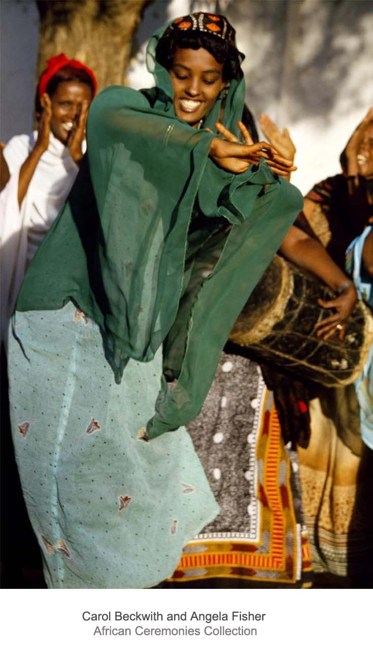 Africa   Women dancing during a nomadic festivity. Somalia - Ethiopia    From the Indian Ocean to the Somali-Ethiopian interior, nomadic festivities always includes dance and song. After the rains, camel herders serenade eligible girls and impromptu dances in many different styles frequently occur. In the hinterland, women perform seductive dances using veils to the accompaniment of female drummers.   ©Carol Beckwith and Angela Fisher