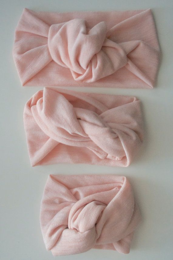 Timeless & comfortable knot turban headband for baby in sweet pink. By Mama Owl Shop, Est. 2013.
