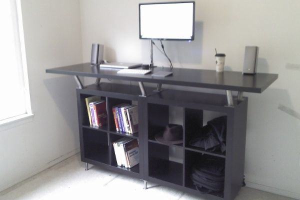 Standing desks have many more health benefits to them than the traditional sit down desks. This Ikea DIY hack makes for a pretty cool standing desk.