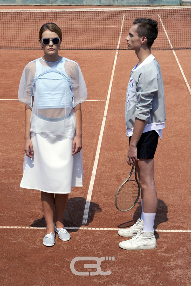 Lookbook: Her: Blue top, sheer tshirt, white midi skirt. Him: White tshirt, grey bomber jacket, black shorts. Tennis court, sport, sportswear, fitness, trends, unisex, campaign photos. Order via facebook, pm or e-mail.