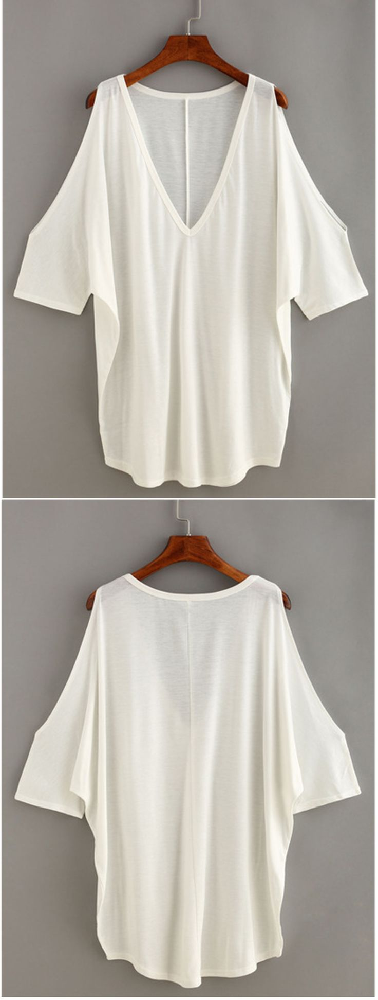 V-Neck Open Shoulder Loose Fit Top. This shirt is great for throwing on, dressing up, and playing around with different styles! It's so versatile and comfortable.