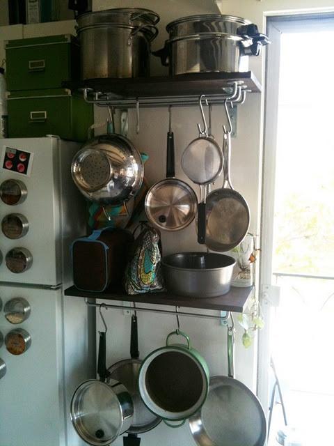 Shelf + Ikea rail = slim pot rack  Can add plate holder or lid rack to top for lids.