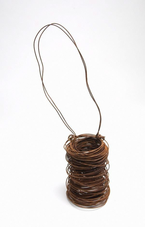 Narrbong (string bag)  Year     2007 Media category     Sculpture  Materials used     rusted chicken-coupe tie wire Dimensions      45.0 x 10.0 x 10.0cm