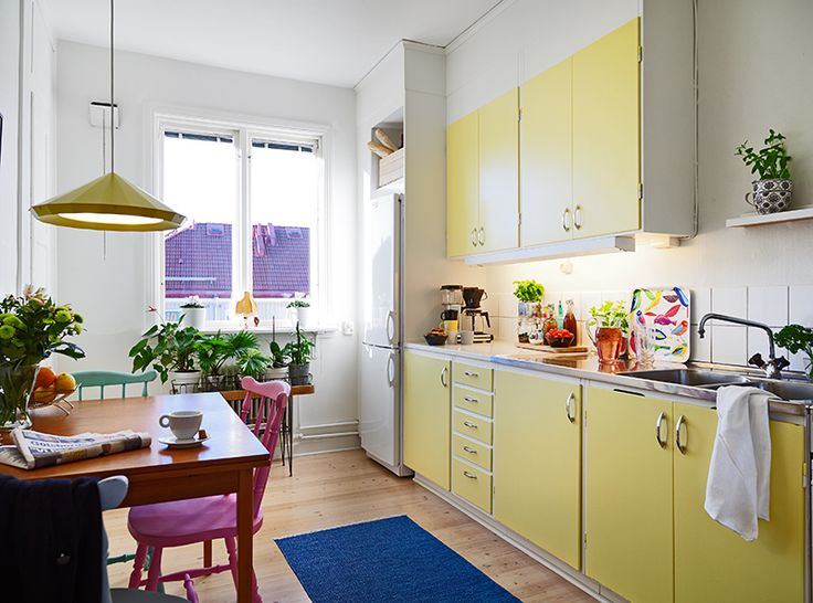 "The Frugal Aesthetic | Blog | Positive Downsizing - ""my studio apartment obsession"" yellow kitchen love!!!"
