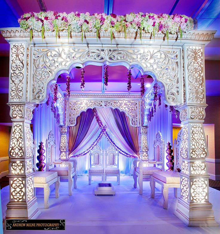Mandap with beautiful purple rustic draping. Indian wedding decor