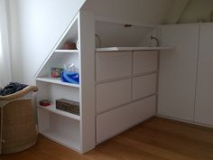 insert book shelves into loft eaves storage - Google Search
