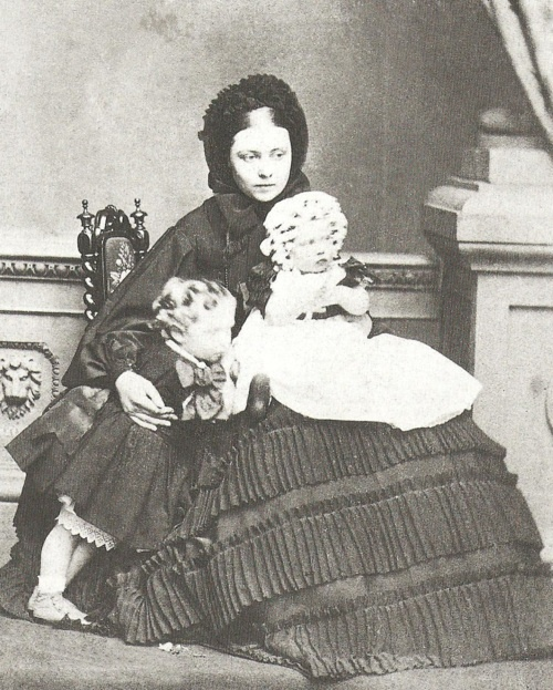 Queen Victoria's daughter Empress Victoria with her oldest two children Wilhelm (*1859) and Charlotte (*1860), all in mourning, probably for their (great)grandmother, the Duchess of Kent, who had died on 16 March 1861.
