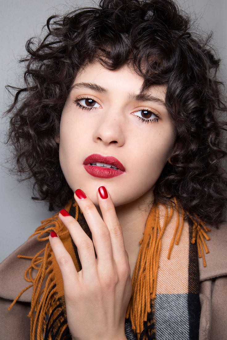 Yes, Curly Bangs Are Back—Heres How to Pull Them Off