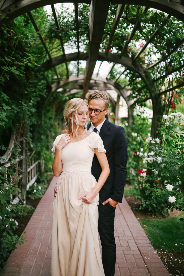Modest wedding dress with flutter sleeves by Alta Moda. Photo by Mandi Nelson