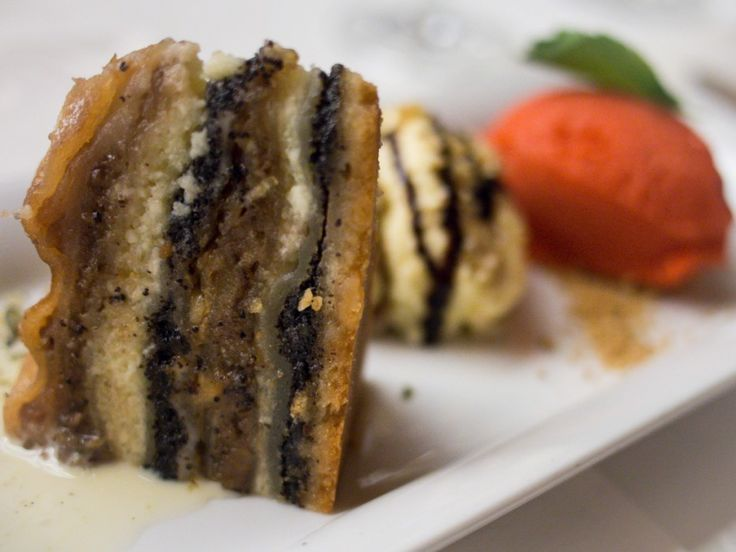 Prekmurska gibanica is Slovenia's national cake with layers of strudel dough, poppy seeds, cottage cheese, nuts and apples.