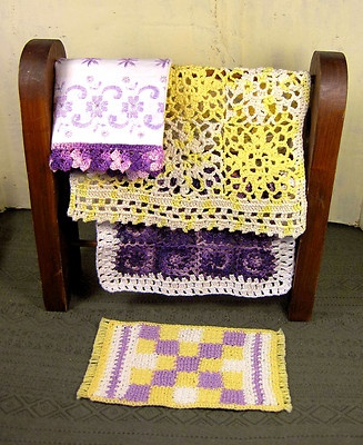 I sold this miniature crochet lot on ebay - lots of lacy dollhouse bedspreads featuring yellow and purple.  Pugcentric Pursuits.