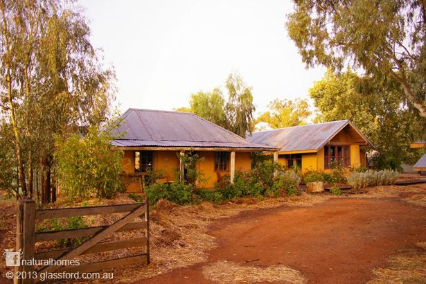 John and Susan Glassford run Huff n Puff Strawbale Constructions in Ganmain, NSW, Australia. Their home is a collection of seven buildings connected by paths. Each of them is clay plastered and insulated with wool at less than $1/kg. More, including video, at www.naturalhomes.org