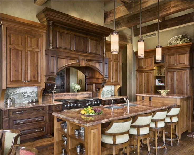 Warm and rustic kitchen with large island.  #kitchens #kitchendesigns homechannetlv.com
