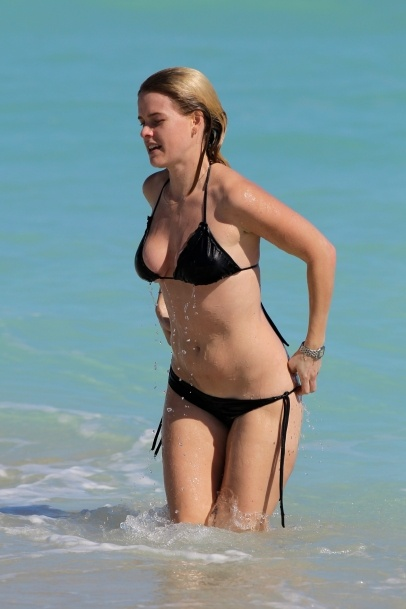 English actress Alice Eve at the beach in Miami Beach, FL after eating lunch at her beachfront hotel the Soho Beach House. Alice, 30, put on sunscreen on her sunlounger before taking a long walk on the beach. The 'Men in Black III' star later cooled off with a swim in the ocean with a friend. 11-24-2012
