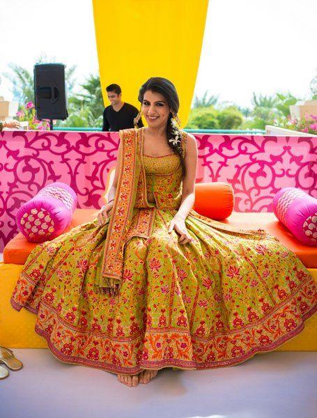 New lehenga styles, Gorgeous lehenga ideas, Unique lehengas | Tarun tahiliani pale green lehenga with red and pink Kashmiri embroidery all over | mehendi lehenga ideas