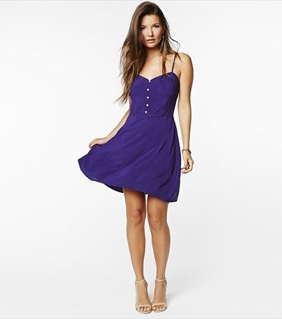Fun and flirty! This purple button down flare dress is perfect for wearing to lunch with the girls!
