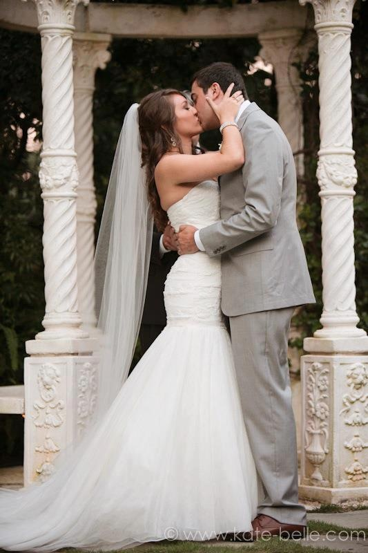 wedding kiss. first as mr and mrs.