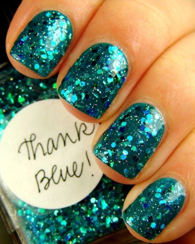 Glittery blue nail polish