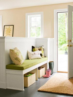 """Look to the spaces below tables and benches you already own.  """"If it has four legs, you can probably put baskets or bins underneath,"""" says professional organizer Monica Ricci of HGTV's Mission Organization. One genius example for the entryway: Arrange rolling canvas bins below a console and put incoming catalogs in one, stuff to recycle in another, trash in a third."""