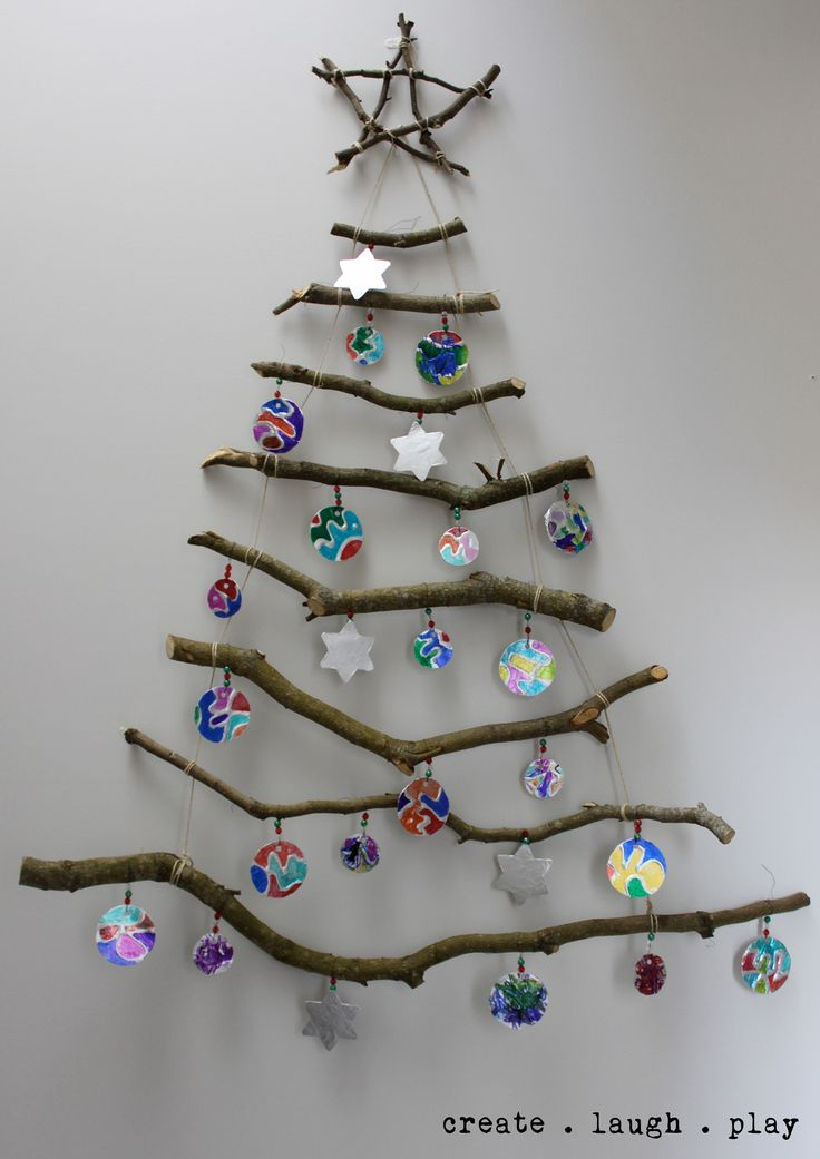 Our wall hung stick Xmas tree with the kids tinfoil baubles,