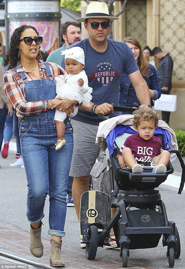 Happy family: Tamera Mowry-Housley looked like the perfect mother as she cradled her baby daughter Ariah while indulging in a spot of shopping with her family at a shopping mall in Los Angeles on Monday