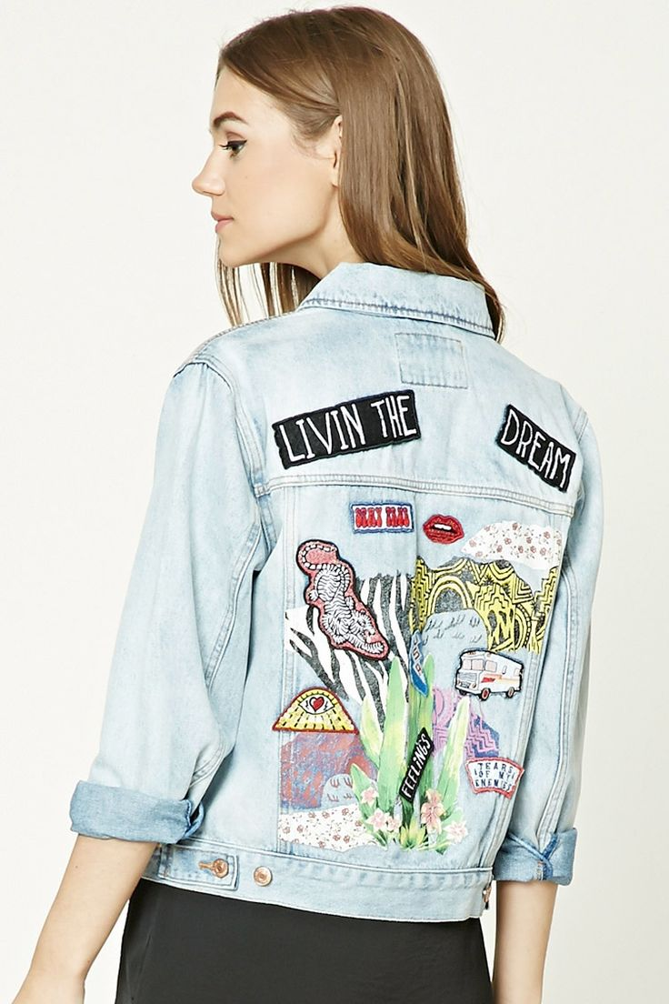 "A denim jacket featuring ""Living The Dream"" and various patches on the back, a basic collar, button front, button chest pockets, side slit pockets, long sleeves, and a boxy silhouette."