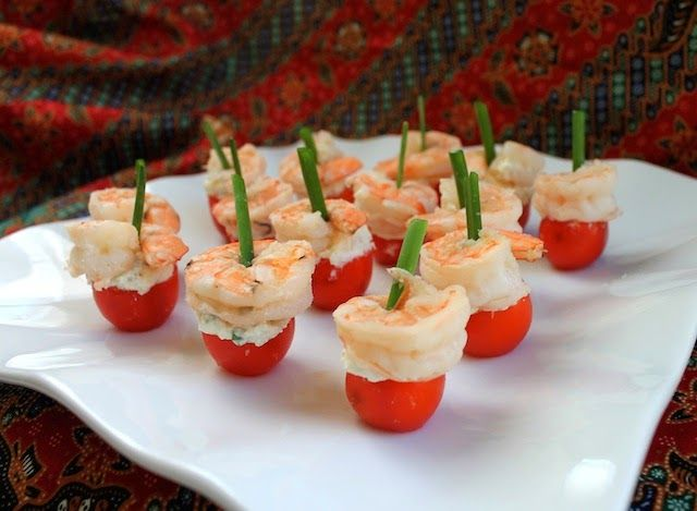Cherry tomatoes filled with seasoned feta and topped with shrimp make one of the prettiest, easiest appetizers you can serve.