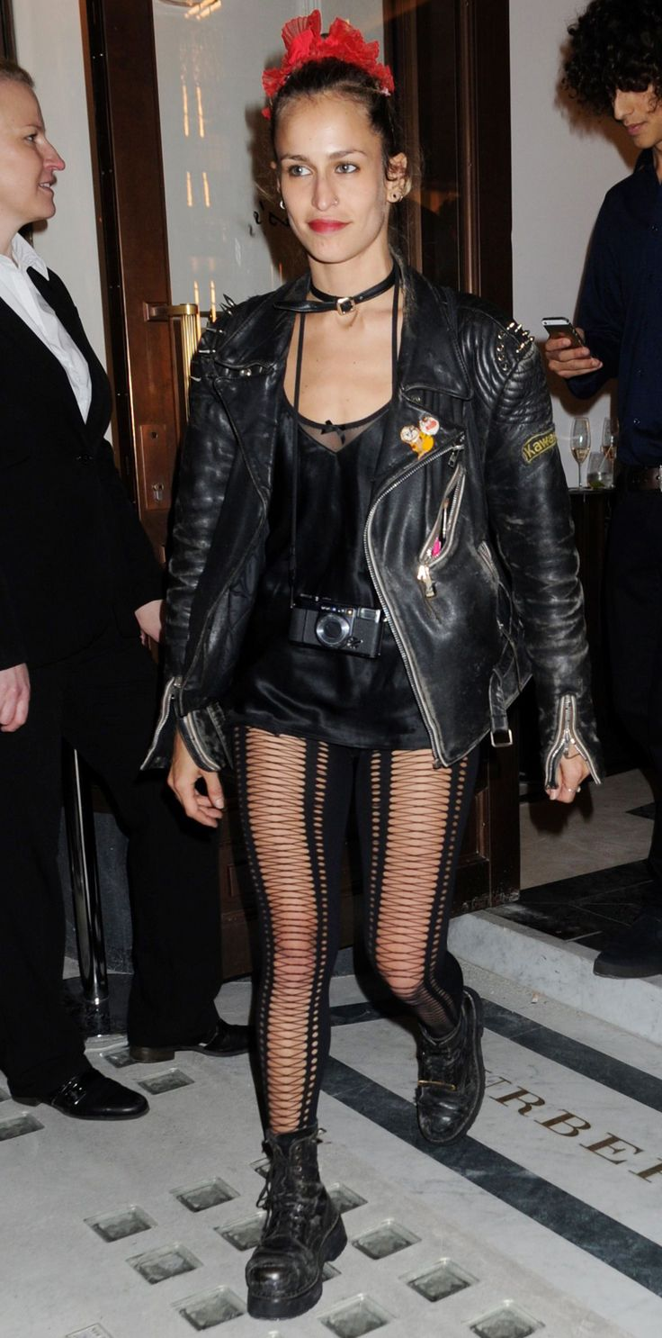 Laddered trousers, leather jackets, chunky combat boots and a silky lace cami; Alice Dellal's night-time get-up is our idea of goth heaven.