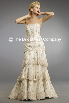 Amber:This elegant strapless dropped waist wedding gown, has a beautiful vintage style beaded lace overlay to give an elegant feel. Features a sweetheart neckline. Tiered skirt that falls effortlessly. The low back and small button detail finish off the vintage style to this wedding dress.