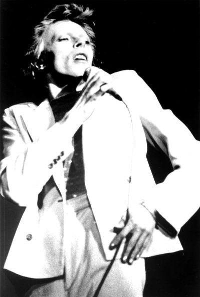 Musician David Bowie performing onstage during the Diamond Dogs tour in 1974 in Los Angeles California