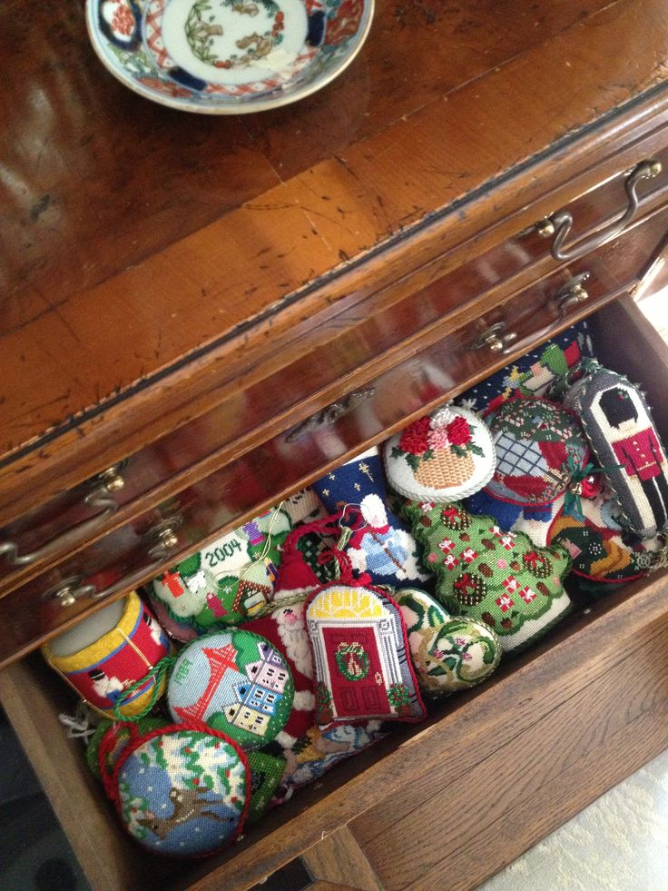 Drawer full of needlepoint Christmas ornaments
