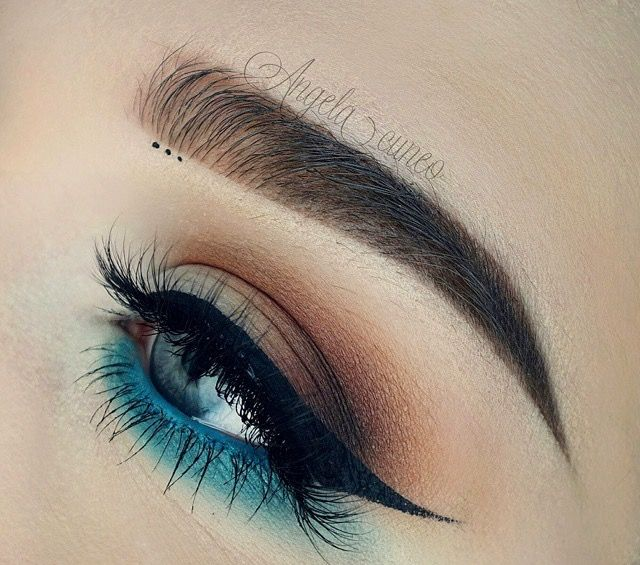 I like the blue shadow under the eye. would do teal